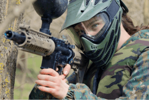 girl playing paintball with a camouflage suit